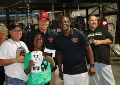 Jessie Vargas and Curtis Hunt with boxing glove drawing winner